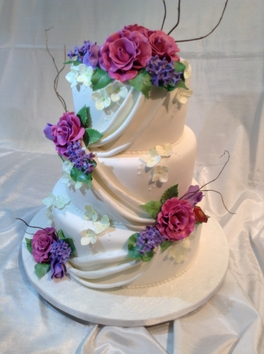 SPECIALIZING IN UNIQUE CUSTOM MADE WEDDING CAKES SPECIAL OCCASION